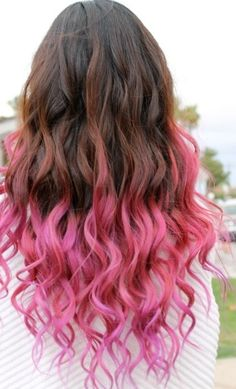 I'm not usually into hair dye, but I love that this is a brunette with pink. It almost makes me want to do it briefly right before I'm ready to cut my hair short.