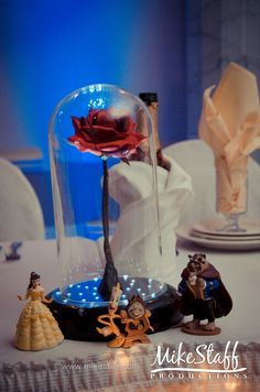 Our movie is Beauty and the beast.. I'd love this sitting on the bride and groom table. <3