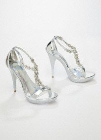 """Glam up any outfit with these metallic high heel sandals.   Crystal accents adorn this high-fashion metallic sandal.  Great for dressing up any outfit for any occasion.  4 3/4"""" heel, 1"""" platform, leather insole.  Imported.  Available in: Silver. In store only."""
