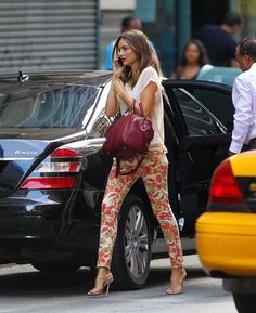 Miranda Kerr in NYC- Paige floral denim and a raspberry handbag