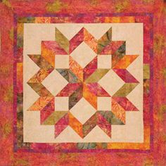 Carpenter's Star quilt...8 fat quarters & background/border fabric