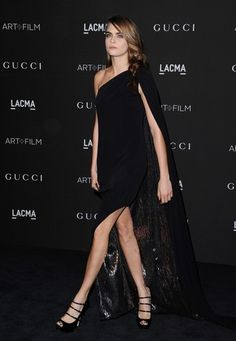 Top model Cara Delevingne wore a black, one-shoulder Gucci Premiere gown with a glittering inner lining.