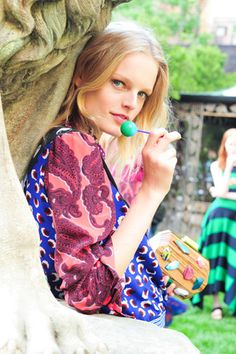 Hanne Gaby Odiele posed with a lollipop and bejeweled wooden clutch at Stella McCartney's Resort presentation.