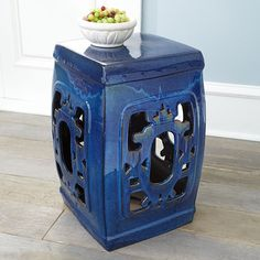 "Dimensions: approx 13""sq. x 20""h    Versatile and sturdy   Ornate design  Each piece is uniqueWith its sturdy yet ornate cutout design and blue color, this ceramic stool can function as an additional seat, a garden accent, or a place to prop your feet. Each stool will vary slightly in color. View this product on our blog."