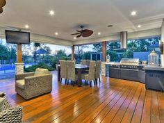 Fully equipped outdoor entertaining area overlooking the pool. Stunning.