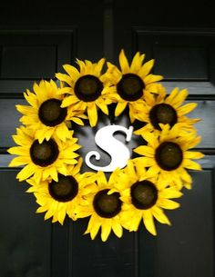 "Sunflower Wreath! Just a foam wreath, some hot glue, and fake sunflowers. Hung the ""S"" with a pipe cleaner."