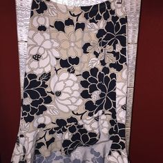 """BCBGMaxAzria Asymmetrical Skirt BCBGMaxAzria light brown, flowered asymmetrical skirt. Front is higher than the back. Skirt is knee-length. Size XS. Waist 11"""" (but stretches to 16""""); length 19/20"""" (front) & 24"""" (back). Worn a few times. Originally purchased at Dillard's. Material is 93% polyester & 7% spandex so it is very stretchy & soft! BCBGMaxAzria Skirts Asymmetrical"""