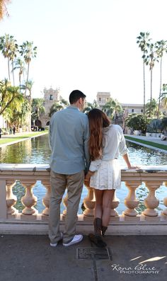 Engagement, Save the Date photography ideas in Balboa Park San Diego. Save-the-Date, engaged, engagement, Prado, love, couple, outdoor, romantic, ideas, nature, bridge, ring, forest, tropical, architecture, arch, arches, lily pond