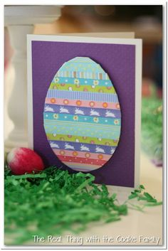 Large egg; looks like rows of ribbon or tape. Could use this idea for lots of other themes.