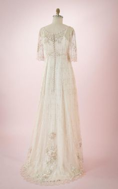 4b947d3059eb Boho-Style wedding dress of embroidered netting over a double silk satin slip  dress, sweep train, mid-length sleeve, vintage/Hippie Inspired