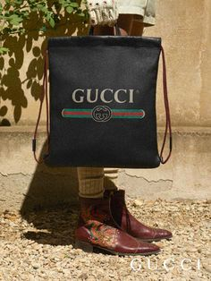 c6aebcca24e The retro-style Gucci vintage logo embellish drawstring backpacks featuring  two leather handles to allow