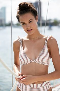 Kingsley Striped Bikini Top | American made super femme triangle shaped bikini top featured in a shimmery stripe design with ruffle detailing on the shoulders.   * Double adjustable straps * S-hook closure with 3 loops * Removable pads