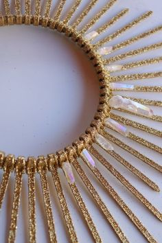 crown tiara Gold & glittering spiked halo crown style) made of zip ties, this spiked halo headpiece sparkles in direct sunlight and adds a glowing goddess effect to any outfit feat Headdress, Headpiece, Halo, Festival Costumes, Diy Hair Bows, Clear Quartz Crystal, Carnival Costumes, Tiaras And Crowns, Costume Makeup