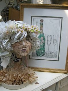 Vignettes Antiques ...somebody has spent time creating the mannequin head...well done.