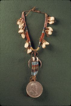 People: probably Pikuni (Piegan) [Blackfeet Nation, Browning, Montana] (attributed) | Object: Necklace with Andrew Jackson peace medal | Date created: 1829-1880 (medal struck in 1829; beadwork added later) | Place: Browning, Blackfeet Reservation; Glacier County; Montana; USA (inferred) | Materials: Silver, hide, elk tooth/teeth, eagle claw/claws, glass bead/beads