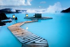 """""""Blue Lagoon"""" in Reykjavik, Iceland: a geothermal spa heated by mother nature (104°F), surrounded by piles of snow all year long"""