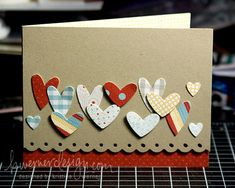 Simple and cute. I like the different sizes of hearts (or butterflies). scalloped edge along border is nice contrast