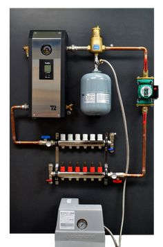 Pre-assembly panel for hydronic water floor heating system including boiler, manifold and pump Hydronic Radiant Floor Heating, Hydronic Heating, Pex Plumbing, Heating And Plumbing, Underfloor Heating Systems, Water Heating Systems, Mechanical Room, Plumbing Installation, Solar Energy Panels