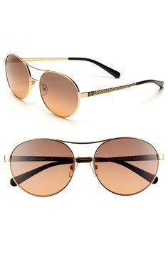 Tory Burch round sunglasses.