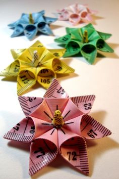 This listing is for one star flower brooch made out of tailors tape measure, in any colour youd like!  Just let me know at check out what colour you