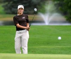 Claymont's Shelby Thompson chips onto the green on her way to the low score of the day Wednesday during the Division II Sectional at River Greens Golf Course in West Lafayette. Thompson shot a 73, although Strasburg won the team title at 360, ahead of second-place Claymont's 366.