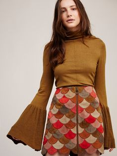 Midnight Rider Suede Skirt | Luxe suede mini skirt featuring a colorful scalloped design. This retro-inspired style features an exposed zip front closure. Lined.