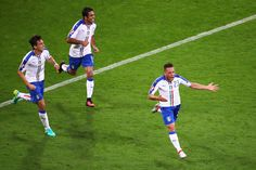 Emanuele #Giaccherini (R) of Italy celebrates scoring his team's first goal with his team mates Matteo Darmian (L) and Eder (C) during the UEFA EURO 2016 Group E match between Belgium and Italy at Stade des Lumieres on June 13, 2016 in Lyon, France.