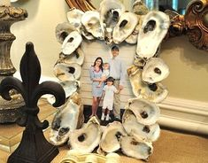 finding many uses for oyster shells...like, an oyster shell picture frame :) @ Erin Brewer