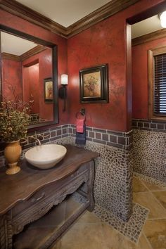 Bathroom: The stone is faux, but it sure looks real! Pretty  rustic....