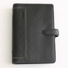AVAILABLE Filofax Holborn Soft Buffalo Leather Black Personal Organizer NEW BNIB RARE  Material: Buffalo leather (soft but sturdy) Color: Black Features:  On the left: 6 credit card pockets a pocket 2 full-height pockets On the right: 2 full-height pockets concealed zipped full-height pocket With a leather pen loop and leather strap popper not visible Dimensions: 135cm x ca. 31cm x ca. 189cm  Ring Size: 23mm  Brand new in box. With various marks and dents on the leather from storage and use…