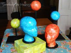 Cover the Styrofoam wig heads from Sally Beauty Supply or Hobby Lobby w/ Mod Podge & Scrapbook Paper!!!