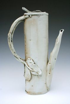 Built from thin slabs and treated with multiple engobes, oxides, underglaze and glaze washes.