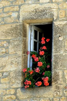 Window in the medieval town of Sarlat in the Dordogne region of France