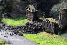 Pompeii starts to CRUMBLE after heavy rain causes part of temple ...