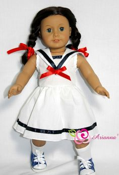 Sailor's Sweetheart dress -  White cotton dress with navy satin trim and sailor collar with red bow.   All seams professionally serged.  Includes:     Dress 2 red hair ribbons Arianna ™ original desig