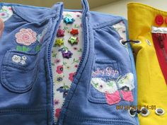 Zipper on Baby Gap jacket. Used lining from hood on page under the jacket. Glitter Star Buttons hidden inside.