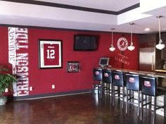 This could be my basement, only with App State, Red Sox, Tarheels and Rangers stuff too. All my teams.