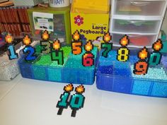 Love love love these custom perler bead birthday candles we made!