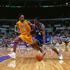 Michael Finley #4 of the Dallas Mavericks drives against Kobe Bryant #8 of the Los Angeles Lakers circa 2000 at Staples Center in Los Angeles, CA.