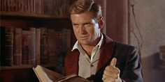The Time Machine (1960) where Rod Taylor finds that the books are crumbling away in the future.  Alas, poor libraries!