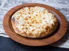 Megruli Khachapuri is a double layer of cheesy Georgian bread. Georgian Food, Georgian Recipes, Cheesy Recipes, Bread Recipes, Cooking Recipes, Saveur Recipes, Pastries Recipes, Cooking Videos, Gourmet