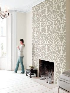 If we do a wallpaper feature wall in the master bedroom, then it would be super cool to put in a faux fireplace that can hold candles on one of the side walls and use the same wallpaper for it.