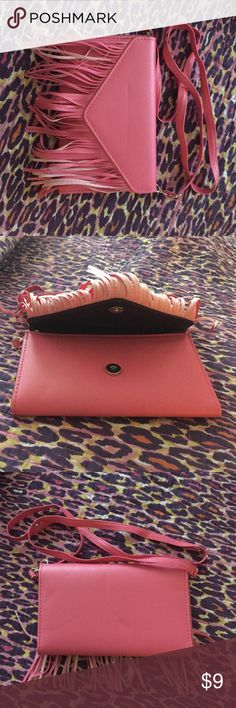 Neon Hot Pink Fringe Cluch Bright hot pink clutch. Small to medium sized. Very bright and eye catcher. Never worn. Bags Clutches & Wristlets