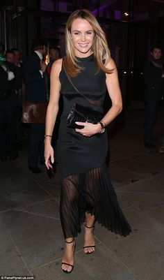 Out and about: Amanda Holden looked lovely on Thursday evening as she was pictured leaving...