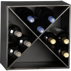 Gunmetal panels intersect to stow 12 bottles. Stack for serious cellaring. each unit holds up to 12 bottles Maximum number of cellar wine racks recommended for stacking is 5 Sheet metal with gunmetal finish Wine House, Up House, Wine In The Woods, Modern Wine Rack, Wine Auctions, Wine Online, Wine Storage, Towel Storage, Organization Ideas