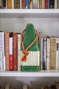 Buoy bookend! http://www.completely-coastal.com/2015/03/Sag-Harbor-home-nautical-decorations.html