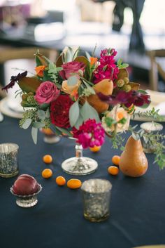 Gorgeous centerpiece incorporating pears, plums, and kumquats!