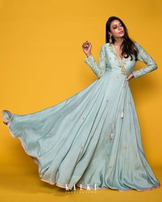 Hues of pastels envelope a stimulating summer romance. Best known for the distinct style, traditional taste and tons of flare, introducing 'Meriah' - The Festive Edit . Indian Wedding Gowns, Indian Gowns, Indian Attire, Pakistani Dresses, Indian Outfits, Kurti Neck Designs, Saree Blouse Designs, Indian Designer Outfits, Designer Gowns