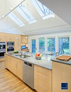 modern house featuring a vaulted ceiling   Bozeman house   Pinterest     Sky lights in the kitchen    yes please  If the house called for clean  modern lines  this would be my kithchen