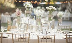 gorgeous table setting!! jars at different heights create a beautiful visual affect & depth .